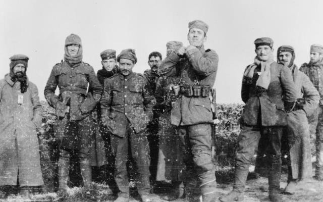 An actual photograph of a December meeting in no man's land from the Imperial War Museum. Note that everyone is cringing from the cold and there are not enough men for two football squads.